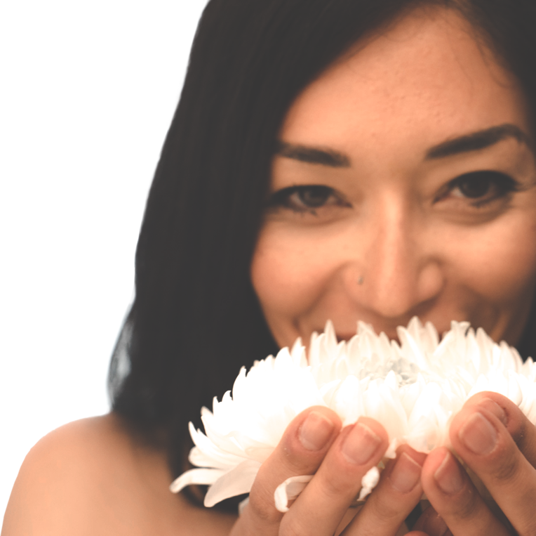 Woman smiling with a white flower